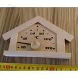 Bastutermometer i form av trähus